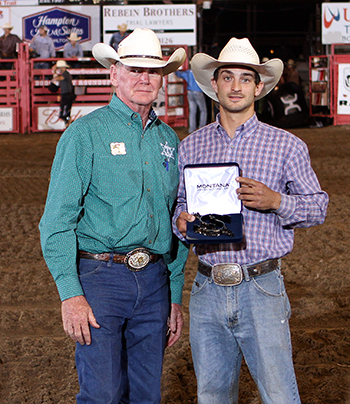 Dodge City Xtreme Bulls champion Elliot Jacoby shows off his trophy spurs, handed to him by Dr. R.C. Trotter, the rodeo committee's president. (PHOTO BY DAVID SEYMORE)