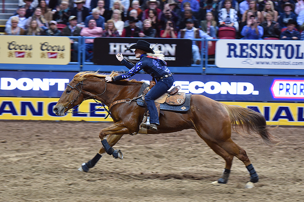 Kylie Weast and Reddy make run for home to stop the clock in 13.70 seconds Friday night to finish third in the second go-round of the National Finals Rodeo. She has already earned $29,885 in Las Vegas. (PHOTO BY ROBBY FREEMAN)