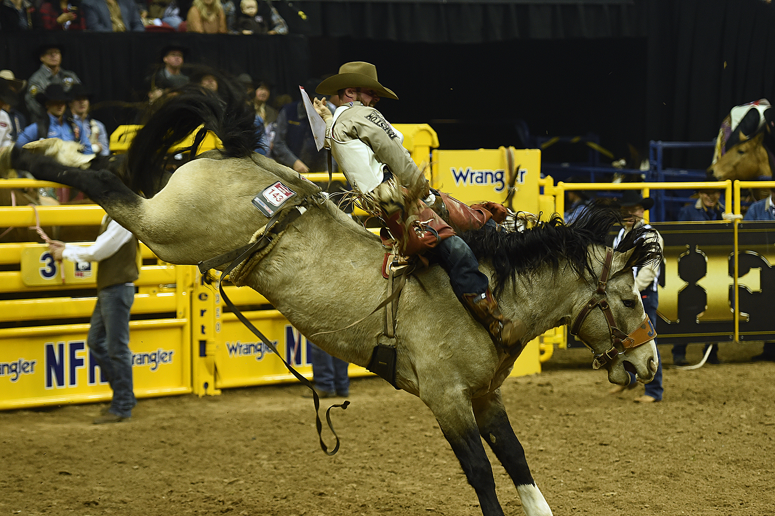 Mason Clements rides J Bar J Rodeo's Colorado Bulldog for 86.5 points Thursday night to finish second in the opening round of the National Finals Rodeo. (PHOTO BY ROBBY FREEMAN)