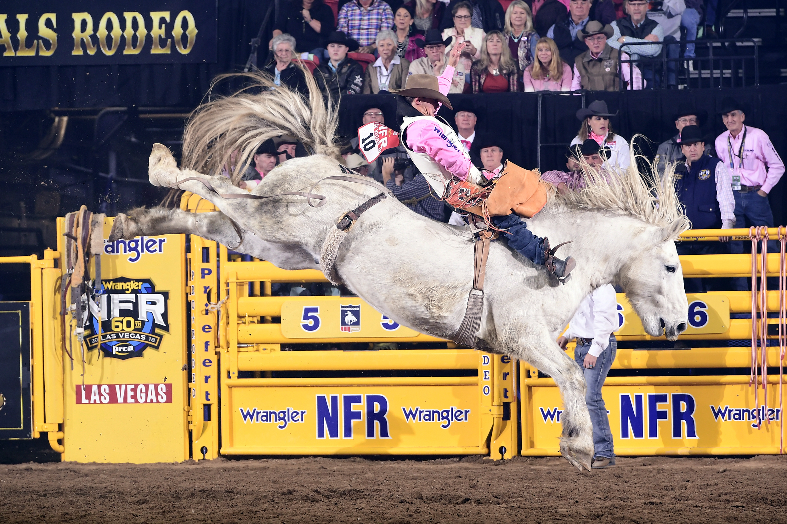 Clayton Biglow rides C5 Rodeo's Virgil, the reigning two-time Bareback Horse of the Year, for a National Finals Rodeo arena record 93 points to win Monday's fifth round. (PRCA PHOTO BY JAMES PHIFER)
