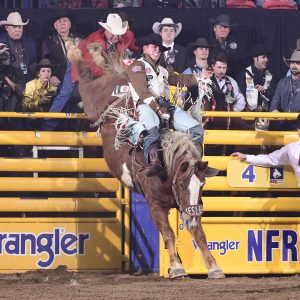 Richmond Champion spurs Kesler's Illegal Smile for 86 points Thursday night to finish fourth in the eighth round of the National Finals Rodeo. (PRCA PRORODEO PHOTO BY JAMES PHIFER)