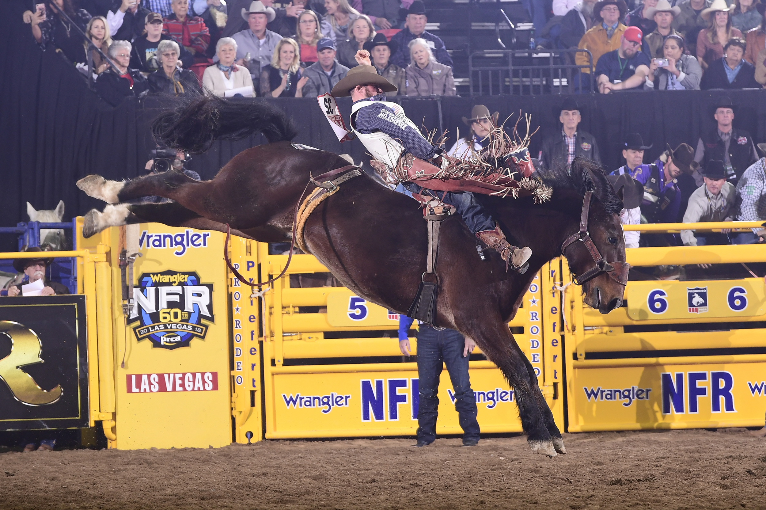 Mason Clements spurs Frontier Rodeo's Full Baggage for 88.5 points Thursday night to finish as runner-up in the eighth round of the National Finals Rodeo. (PRCA PRORODEO PHOTO BY JAMES PHIFER)