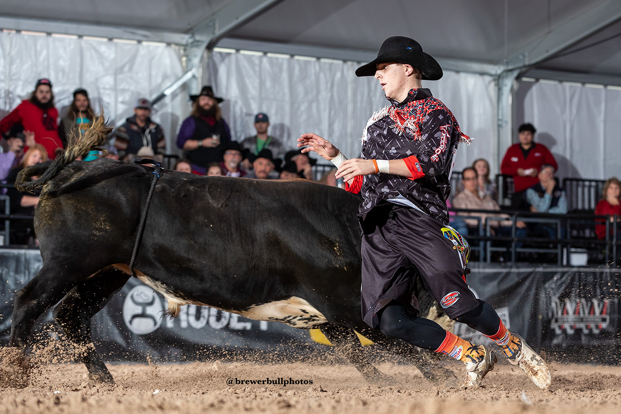 Cade Gibson allows the bull to slide by during his bullfight Tuesday in the second day of the FlexFit Preliminary Rounds of the Bullfighters Only Las Vegas Championship at the Tropicana Las Vegas. (PHOTO BY TODD BREWER)