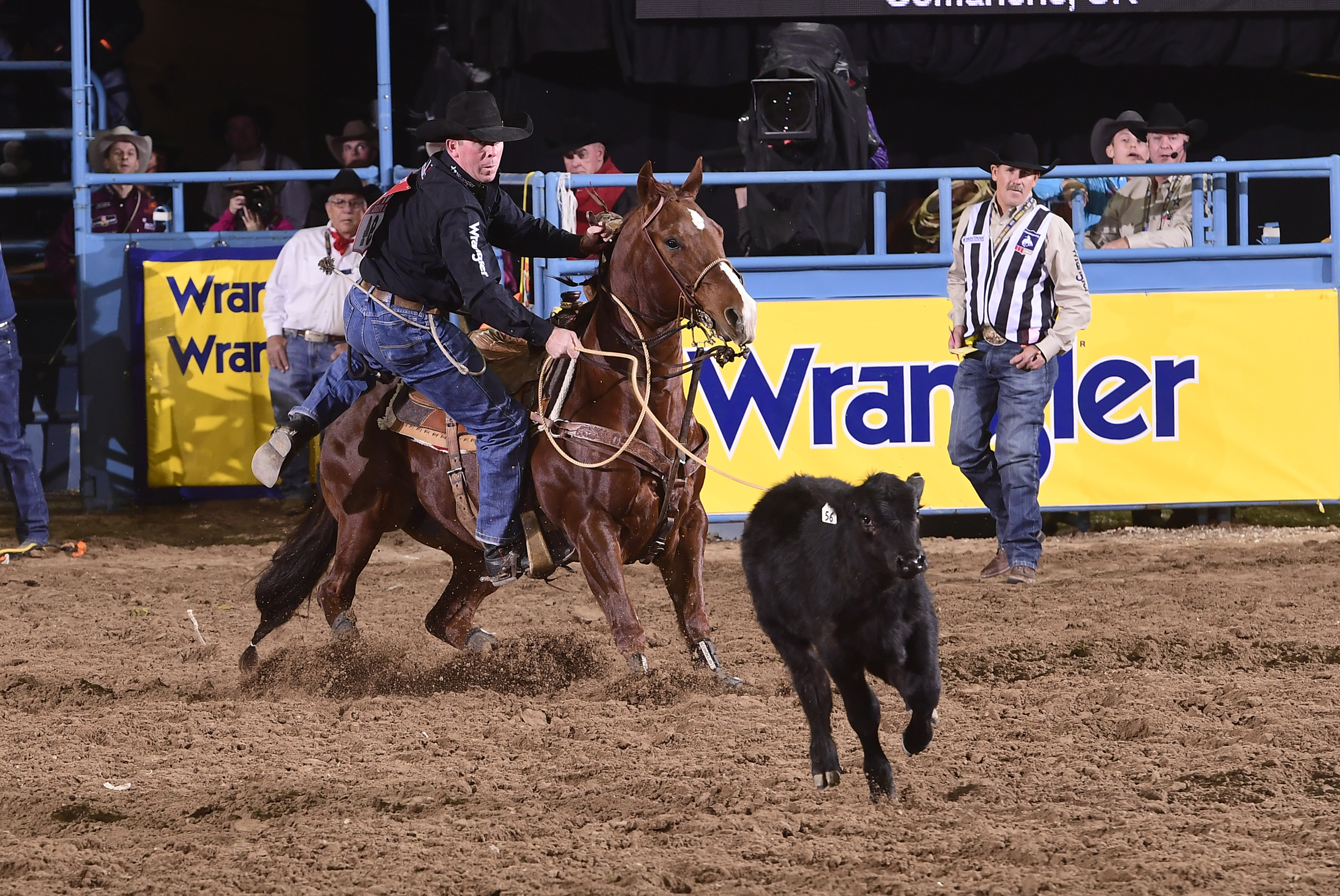 Tie-down roper Ryan Jarrett ropes his calf en route to a 7.8-second run Wednesday to finish fourth in the seventh round of the National Finals Rodeo. (PRCA PRORODEO PHOTO BY JAMES PHIFER)