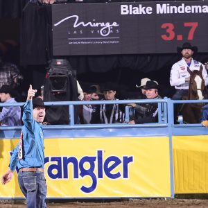 Steer wrestler Blake Mindemann celebrates his 3.7-second run Friday to finish as the runner-up in the ninth round of the National Finals Rodeo. (PRCA PRORODEO PHOTO BY JAMES PHIFER)
