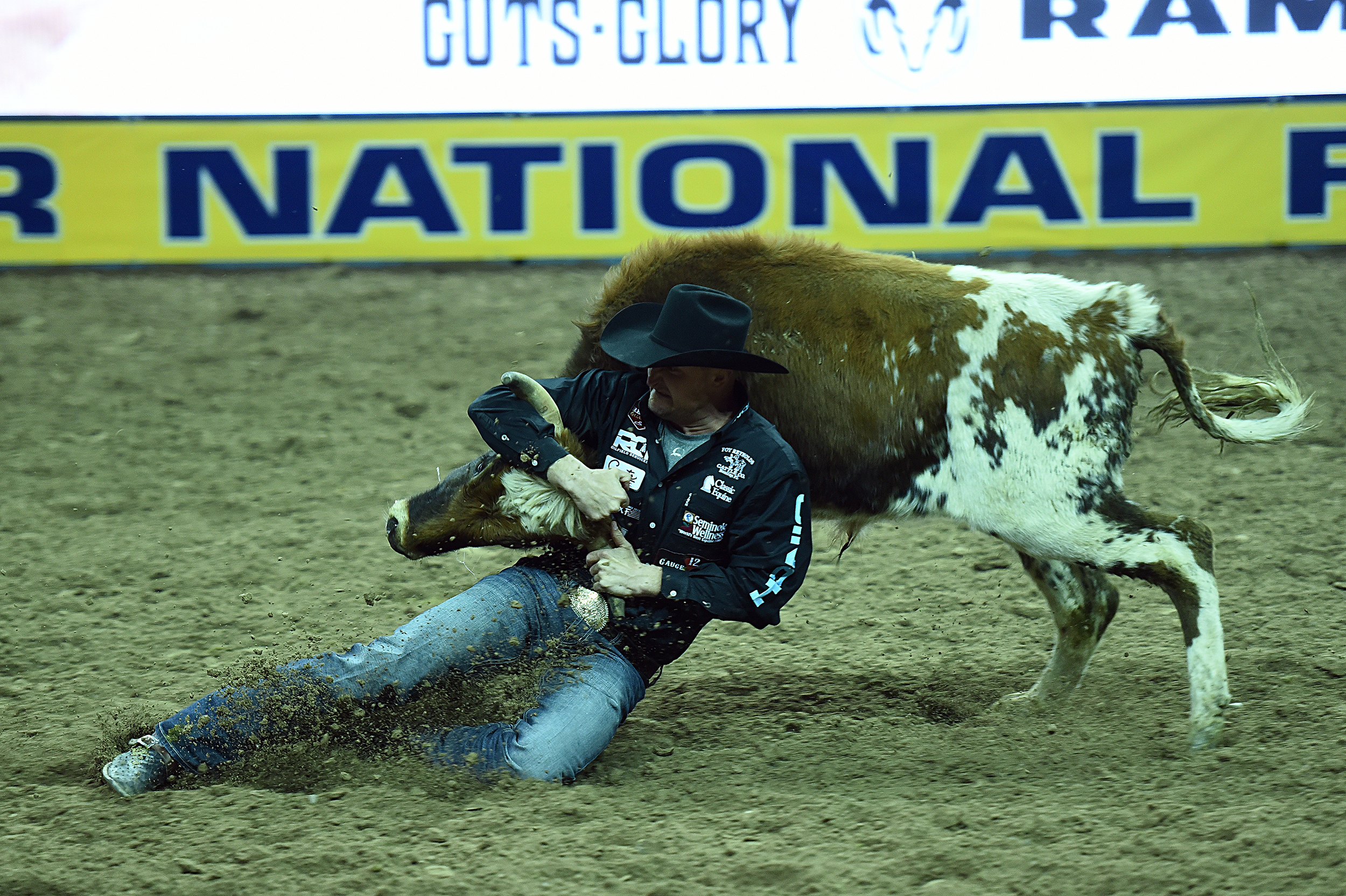 Kyle Irwin wrestled his steer to the ground in 4.0 seconds Thursday night to finish in a tie for third place in the opening round of the National Finals Rodeo. (PHOTO BY ROBBY FREEMAN)
