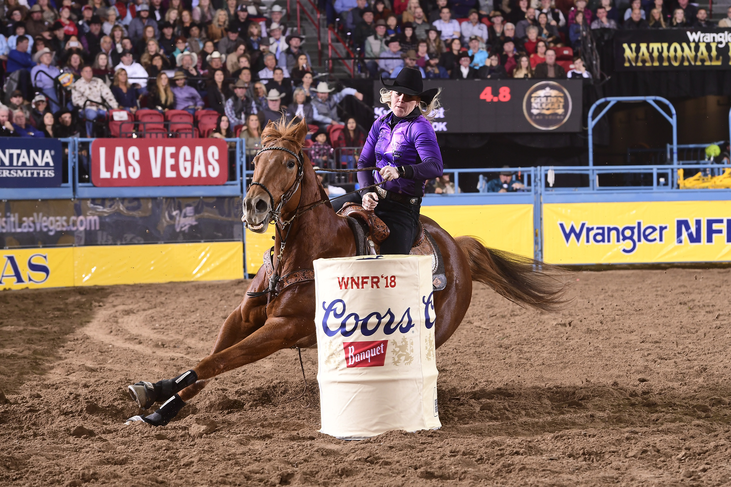 Kylie Weast and Reddy turn the second barrel en route to a 13.74-second run Wednesday to finish in a tie for fourth place in the seventh round of the National Finals Rodeo. (PRCA PRORODEO PHOTO BY JAMES PHIFER)