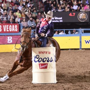 Kylie Weast and Reddy round the second barrel Saturday night en route to a National Finals Rodeo-best 13.37-second run to win the 10th round. (PRCA PRORODEO PHOTO BY JAMES PHIFER)