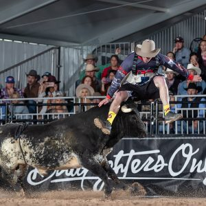 Justin Ward leaps over a bull during the Bullfighters Only Las Vegas Championship. He was named the BFO Rookie of the Year. (PHOTO BY TODD BREWER)