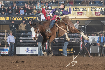 Caleb Bennett rides United Pro Rodeo's Pow Wow Rocks for 85.5 points on Friday night to move into second place in bareback riding in San Angelo. (PHOTO BY RIC ANDERSEN)