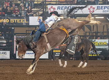 Kody Lamb rides Pete Carr's Pink Cadillac for 86.5 points on Wednesday night and will advance to Friday's championship round of the San Angelo Stock Show and Rodeo. (PHOTO BY RIC ANDERSEN)