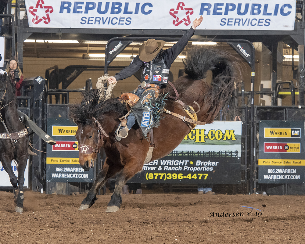 Zeke Thurston rides Rafter H Rodeo's Aces Wild for 88.5 points Wednesday night to take the saddle bronc riding lead at the San Angelo Stock Show and Rodeo. (PHOTO BY RIC ANDERSEN)