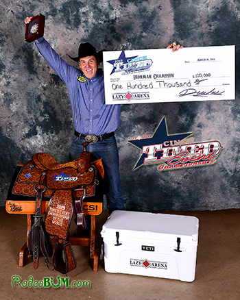Justin Thigpen celebrates with his loot and the championship check after winning the CINCH Timed Event Championship title. (PHOTO BY JAMES PHIFER)