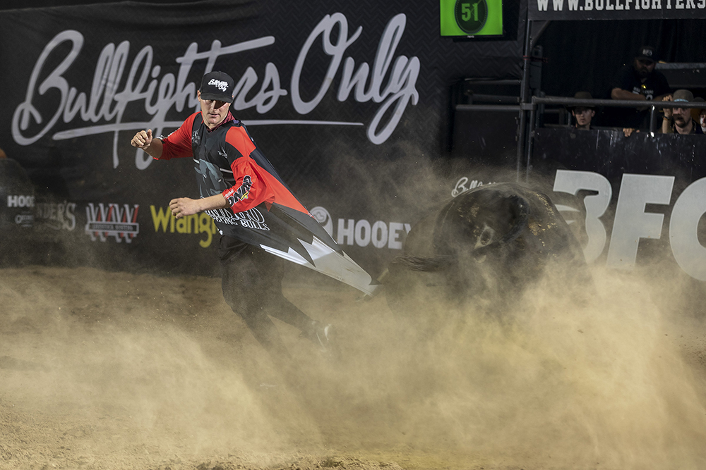 Aaron Mercer slips out of the way of a bull earlier this month in Kennewick, Washington, as the bull grabs ahold of Mercer's jersey with its horn. Mercer has been on a fast rise to the top of Bullfighters Only. (PHOTO BY TODD BREWER)