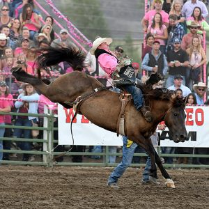 Craig Wisehart won the bareback riding title at Cattlemen's Days in Gunnison, Colorado, a year ago. By posting the highest-marked ride on the rodeo's pink night, he also collected a bonus. (PHOTO BY ROBBY FREEMAN)