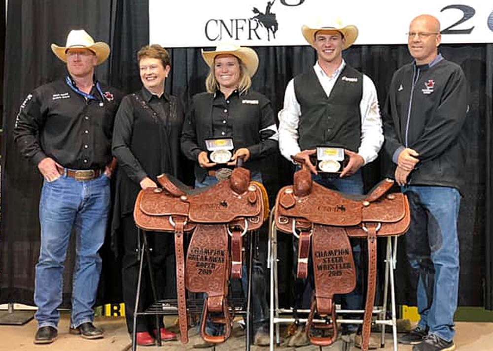 Northwestern Oklahoma State University breakaway roper Taylor Munsell and steer wrestler Bridger Anderson earned national championships this past week at the College National Finals Rodeo in Casper, Wyoming. Pictured are, from left, coach Stockton Graves, university president Janet Cunningham, Munsell, Anderson and athletic director Brad Franz. (PHOTO COURTESY OF NORTHWESTERN OKLAHOMA STATE UNIVERSITY RODEO)