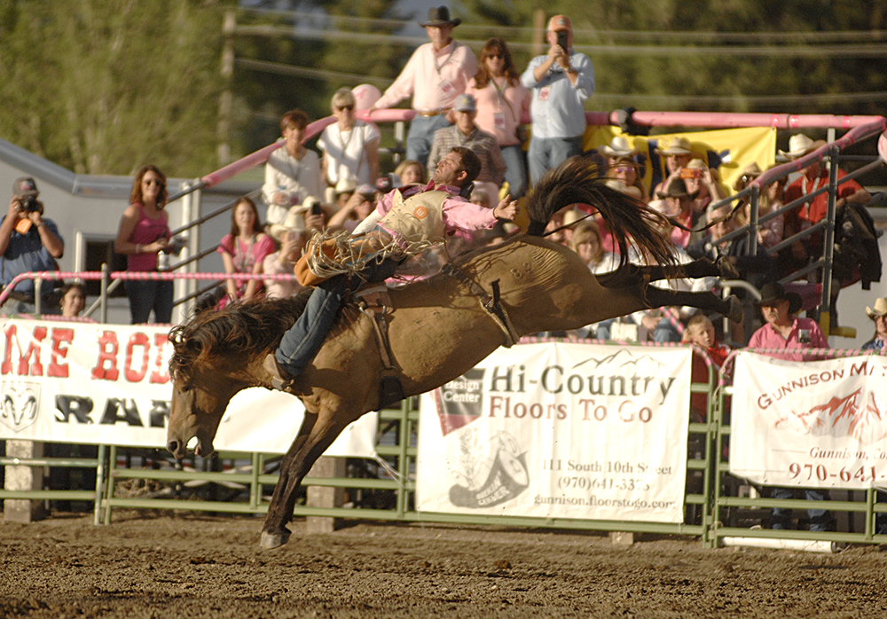 Casey Colletti rides Smith Rodeo's Sun Catcher for 87 points to lead the bareback riding at the Cattlemen's Days PRCA Rodeo in Gunnison, Colorado. (PHOTO BY ROBBY FREEMAN)