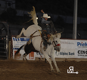 Bradley Harter rides Pete Carr's Another Grey and has the saddle bronc riding lead at the Eagle County Fair and Rodeo. (PHOTO BY ROBBY FREEMAN)