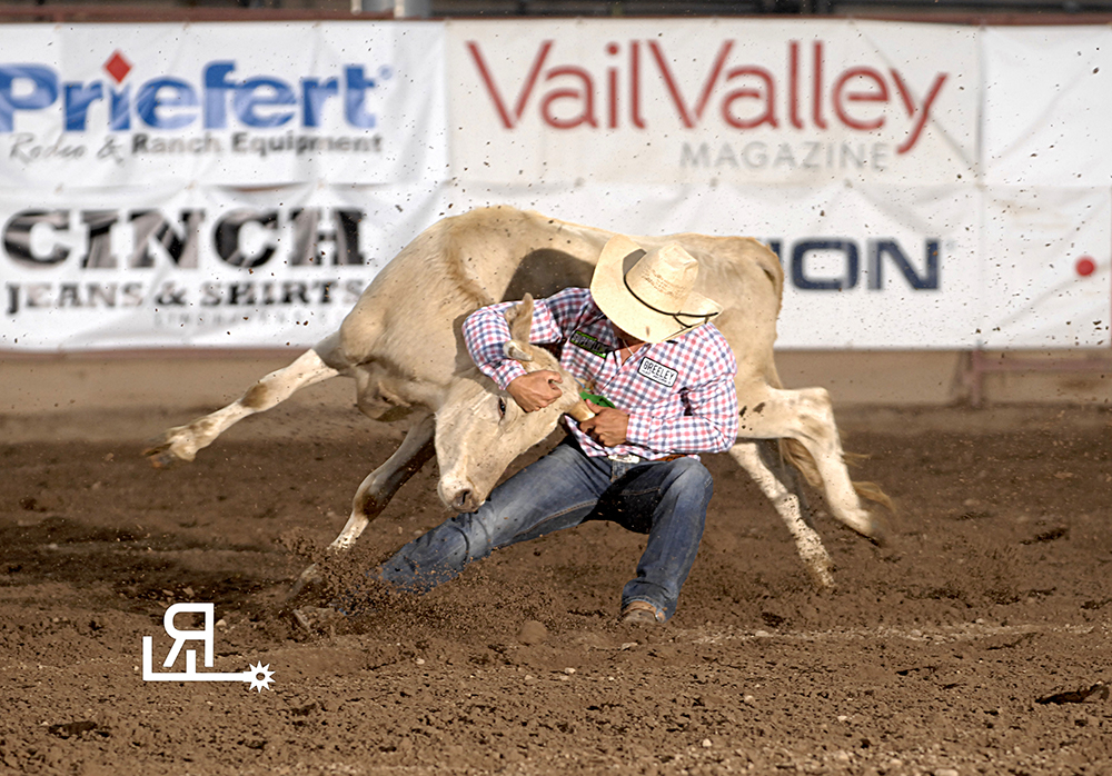 Chisum Docheff wrestles his steer to the ground in 4.4 seconds Thursday night to share the second-round lead at the Eagle County Fair and Rodeo. He placed in the first round and now owns the two-run aggregate lead by seven-tenths of a second. (PHOTO BY ROBBY FREEMAN)