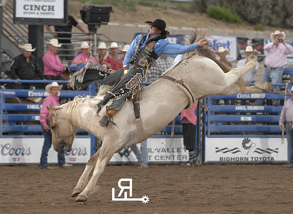 Steven Dent rides Pete Carr's San Angelo Sam for 89 points Friday night to take the bareback riding lead at the Eagle County Fair and Rodeo. (PHOTO BY TODD BREWER)