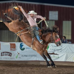 Dalton Davis rides Pete Carr's Cowboy Cowtown during last year's rodeo. The good stock and beautiful weather are just a couple of reasons cowboys and cowgirls love competing in Eagle every year. (PHOTO BY TODD BREWER)