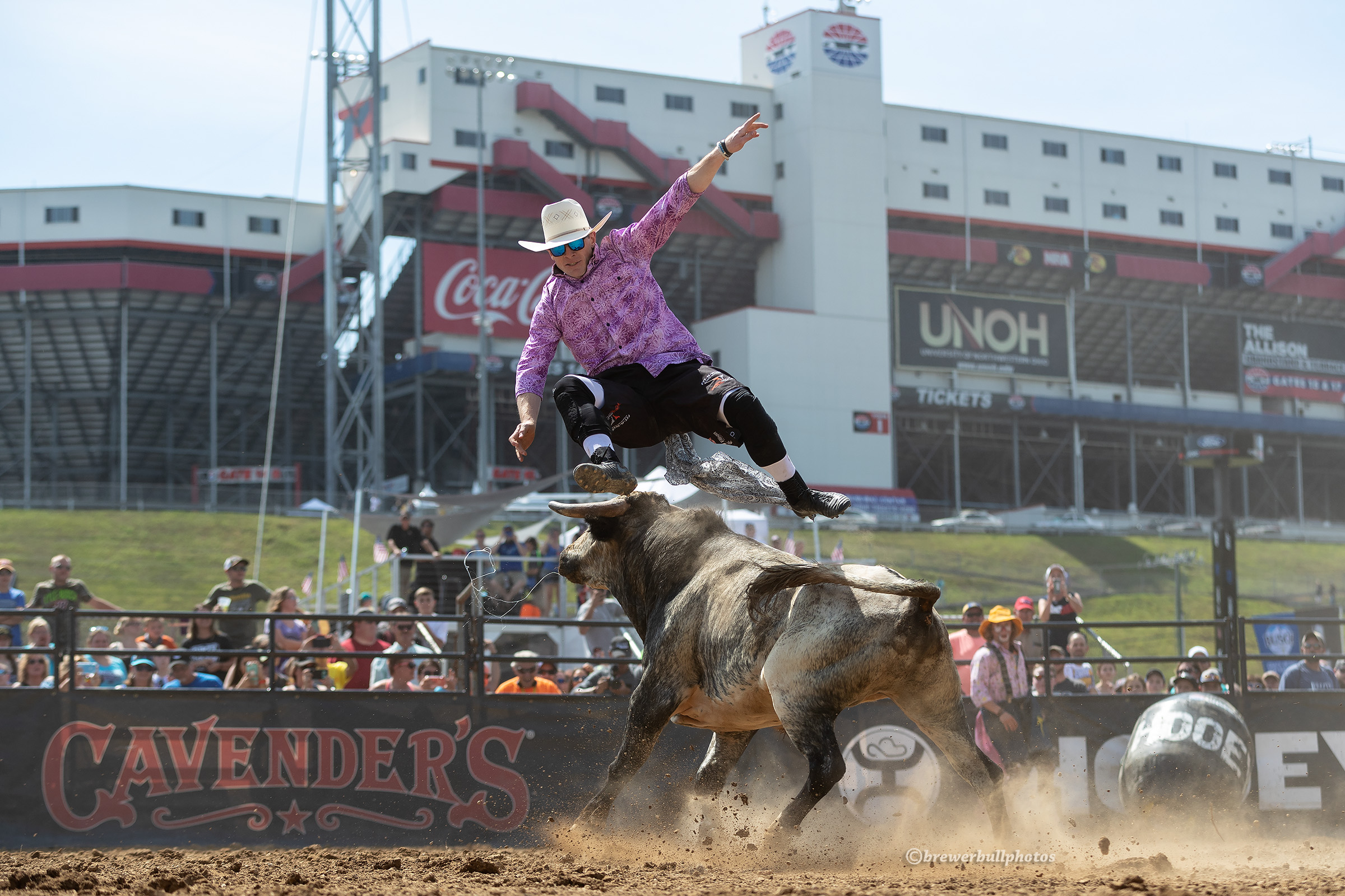 With the Bristol Motor Speedway in the background, Kris Furr leaps over his bull during his Bullfighters Only Speedway Series event title in the northeastern Tennessee community. (PHOTO BY TODD BREWER)
