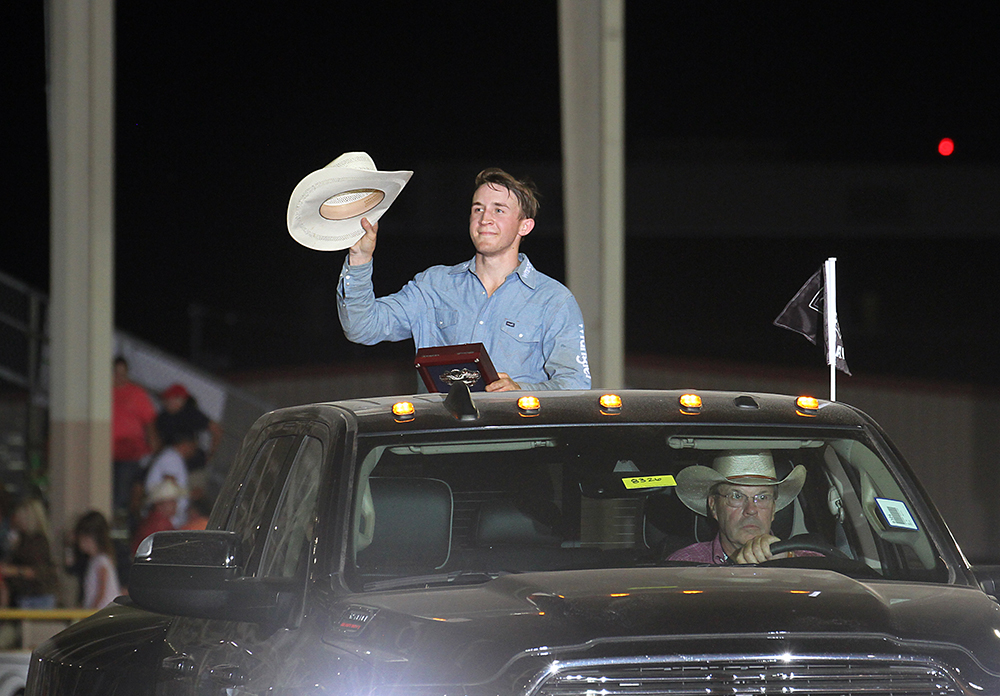 Trey Kimzey takes a victory lap in the back of a RAM pickup after winning the Lea County Xtreme Bulls on Tuesday night. (PHOTO BY PEGGY GANDER)