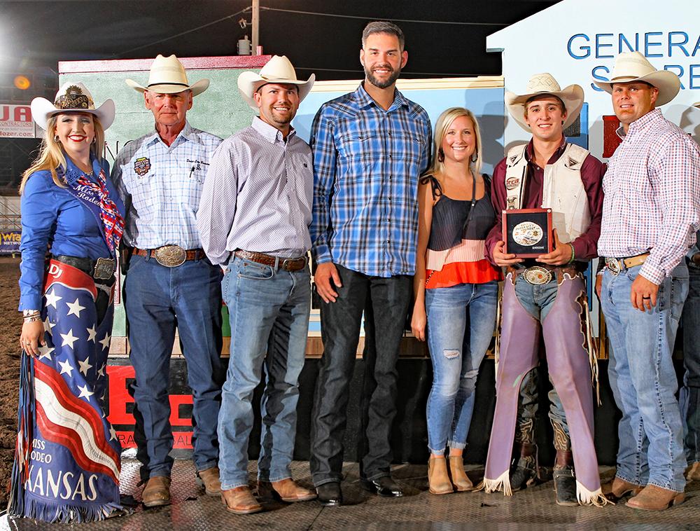 From left, Miss Rodeo Kansas Brooke Wallace, Roundup president Dr. R.C. Trotter, Ryan Deutsch, Ryan Lehmkuhler, Katie Asbjorson, bull riding champion Koby Radley and John Bogner. (PHOTO BY DAVID SEYMORE)