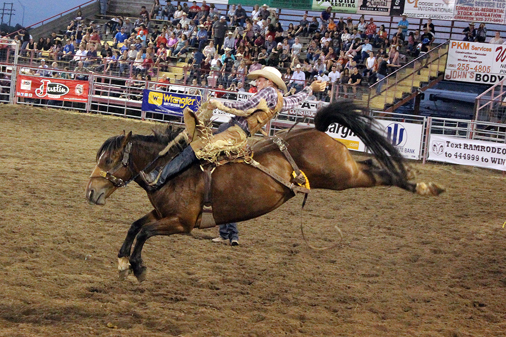 Tegan Smith rides Frontier Rodeo's Bordertown for 87 points in the first round of the 2019 Dodge City Roundup Rodeo. Smith finished third overall and earned nearly $4,000 last year. He and others know they'll have that kind of opportunity at this year's Roundup Rodeo, which takes place next week.