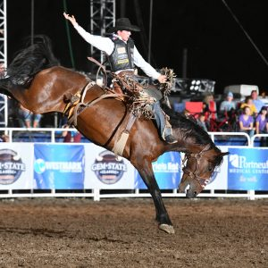 Stetson Wright, a PRCA rookie who sits No. 1 in the all-around world standings, won saddle bronc riding at the Gem State Classic Pro Rodeo with a 90-point ride on Powder River Rodeo's -38 Special. (PHOTO BY AMANDA DILLWORTH)