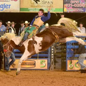 Yance Day rides Pete Carr Pro Rodeo's YoYo for 85 points to take the bareback riding lead at the Waller County Fair and Rodeo. (PHOTO BY DANIEL BECKENDORF)