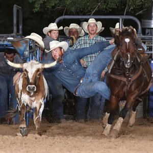 Jacob Edler stopped the clock in 3.7 seconds to share the steer wrestling lead at the Austin County Fair's Rodeo in Bellville, Texas. (PHOTO BY PEGGY GANDER)