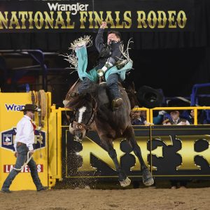 Tanner Aus matches moves with Hi Lo ProRodeo's Pretty Woman for 86.5 points to place fifth in Thursday's eighth round of the National Finals Rodeo. (PRCA PRORODEO PHOTO BY JAMES PHIFER)