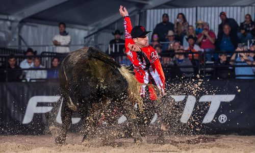 World champion Aaron Mercer of Calgary, Alberta, lets his bull slide by during his BFO Roughy Cup-winning bullfight on Thursday. (PHOTO BY TODD BREWER)