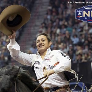 Tim O'Connell makes his victory lap after winning the 10th round, the National Finals Rodeo average title and the bareback riding world championship on Saturday night. (PRCA PRORODEO PHOTO BY STEVEN GRAY)