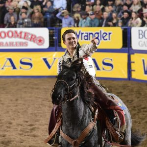 Clayton Biglow makes the victory lap after winning the National Finals Rodeo's eighth round, his fourth straight round victory. (PRCA PRORODEO PHOTO BY JAMES PHIFER)