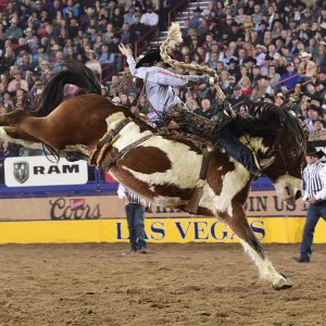 Colt Gordon rides Stace Smith's Top Hat for 87.5 points Saturday night to place for the third time at his first National Finals Rodeo. (PRCA PRORODEO PHOTO BY JAMES PHIFER)