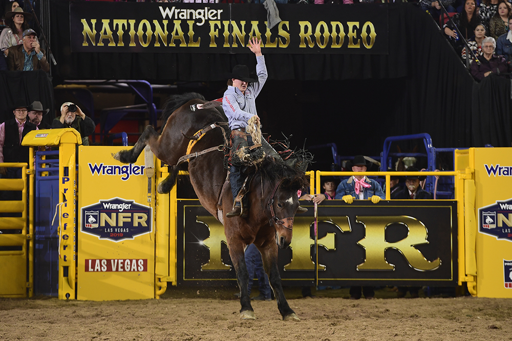 Colt Gordon rides Frontier Rodeo's Maple Leaf for 82 points to place in a tie for sixth place in Monday's fifth round of the National Finals Rodeo. (PRCA PRORODEO PHOTO BY JAMES PHIFER)