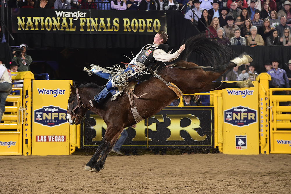 Orin Larsen rides Big Stone Rodeo's Mayhem for 90 points to finish as the runner-up in Wednesday's seventh round of the National Finals Rodeo. (PRCA PRORODEO PHOTO BY JAMES PHIFER)