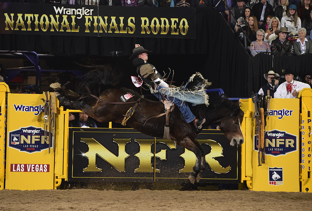 Orin Larsen rides Pickett Pro Rodeo's Shady Nights for 87.5 points to finish the first round of bareback riding in a tie for sixth place. (PRCA PHOTO BY JAMES PHIFER)