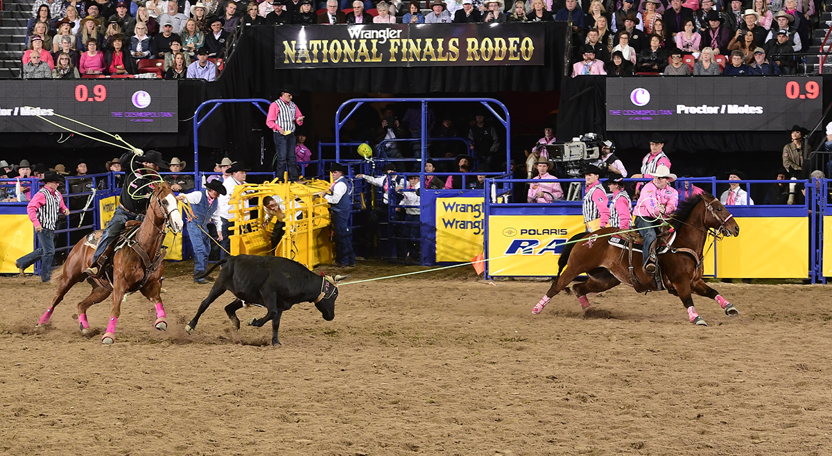 Ryan Motes, left, and Coleman Proctor finish off their 4.4-second run to finish in a tie for second place in Monday's second round of the National Finals Rodeo. (PRCA PRORODEO PHOTO BY JAMES PHIFER)