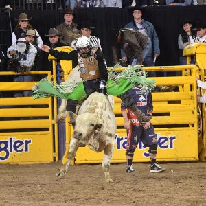 Jordan Spears rode his sixth bull in nine rounds Friday, scoring 85 points on Corey & Lange's Short Bus to finish sixth in the ninth round of the National Finals Rodeo. (PRCA PRORODEO PHOTO BY JAMES PHIFER)