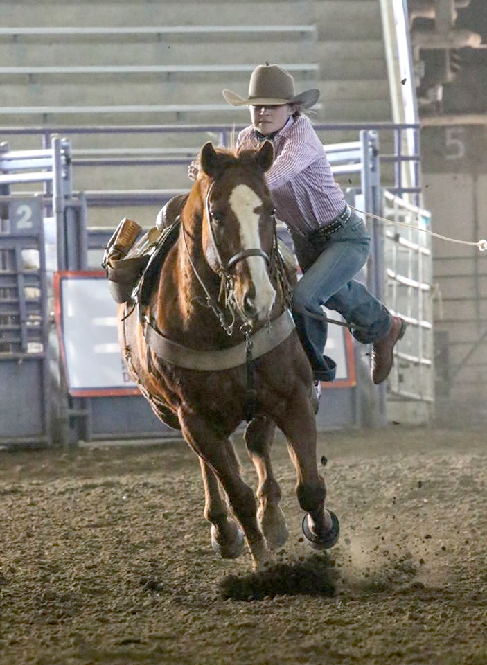 Megan Turek makes a run this past weekend at the Kansas State University rodeo. She finished second in goat-tying. (PHOTO BY AMBER THOMPSON PHOTOGRAPHY)