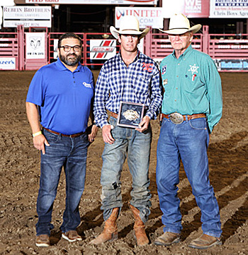 Dodge City Xtreme Bulls champion Trevor Kastner, center, poses with his title buckle with Patrick Falcon and Dr. R.C. Trotter. (PHOTO BY DAVID SEYMORE)