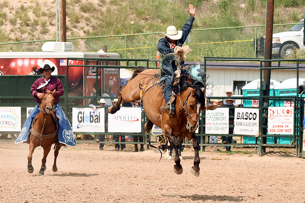 Isaac Diaz rides Frontier Rodeo's Yellowstone for 89 points Sunday afternoon to finish second in the saddle bronc riding at the Guymon Pioneer Days Rodeo. (PHOTO BY DALE HIRSHMAN)