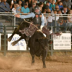 Ty Wallace rides Frontier Rodeo's Big Don for 90 points Saturday night to take the bull riding lead at the Guymon Pioneer Days Rodeo. (PHOTO BY DALE HIRSHMAN)
