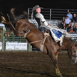 Orin Larsen rides JBC Bent Rail Sourdough for 88 points to share the bareback riding lead at the Cattlemen's Days PRCA Rodeo in Gunnison, Colorado. (PHOTO BY ROBBY FREEMAN)