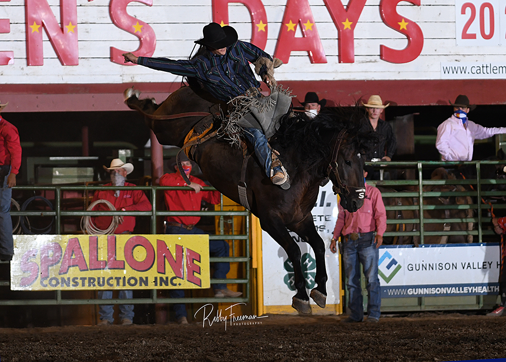 Tannner Butner rides Stace Smith's Dreamliner for 87.5 points to share the saddle bronc riding title at the 2020 Cattlemen's Days PRCA Rodeo. (PHOTO BY ROBBY FREEMAN)