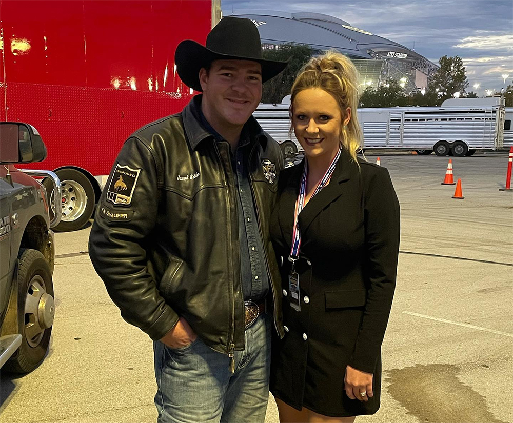 Jacob Edler and his fiance, Moriah, pose outside Globe Life Field before Saturday's third round of the National Finals Rodeo. (PHOTO COURTESY OF MORIAH GLAUS' FACEBOOK PAGE)