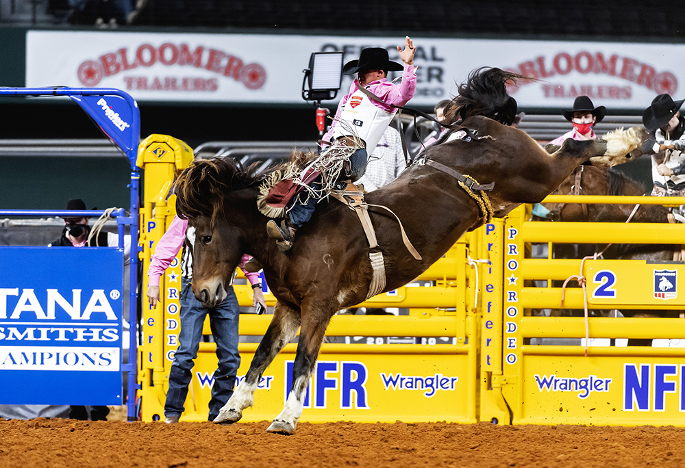 Clayton Biglow spurs Pickett Pro Rodeo's Top Flight for 89 points to win Monday's fifth round of the National Finals Rodeo. (PHOTO BY JAMES PHIFER)